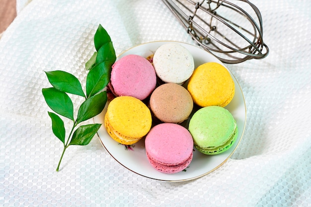 Small top view of french cakes. sweet and colorful french macaroons.