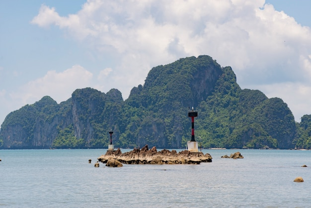 Small tower lighthouse signs in the bay located in the southern tip of thailand.