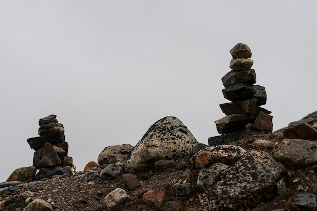 Small towers made of stones from travelers on the passes.