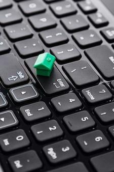 Small toy house over keyboard