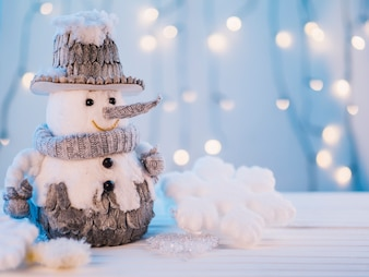 Small toy snowman on table
