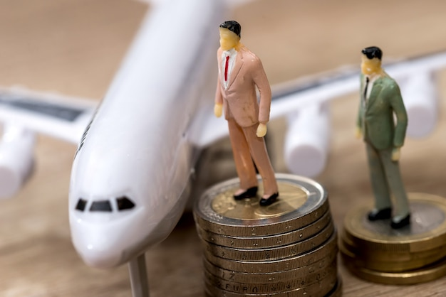 Small toys people find on euro coins, near airplane
