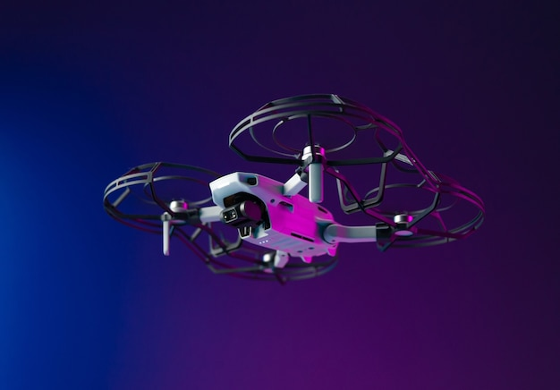 A small unmanned aerial vehicle with the protection of the propeller blades in flight on a neon background inside the room