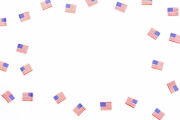 Small usa flags scattered on white background