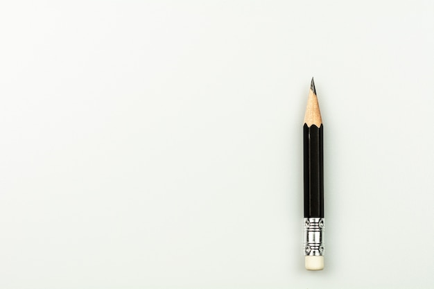 Small used pencil isolated on white background.
