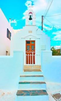 Small white greek church in mykonos town, greece