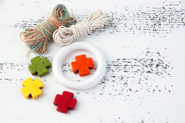Small white hoop, thread and stone bright crosses
