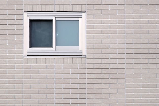 Small window on modern wall