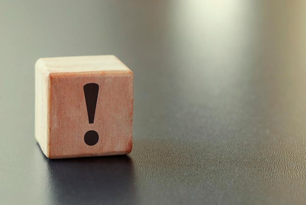 Small wooden block with exclamation mark