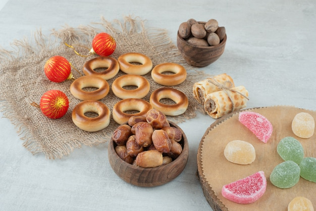 A small wooden bowl of dried fruits with jelly candies on white background. high quality photo