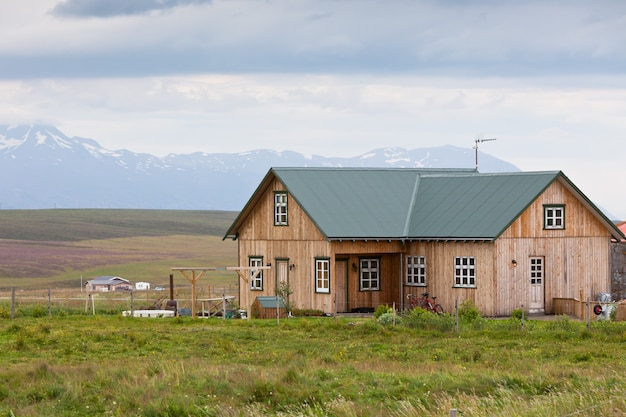 Small wooden cottage in iceland landscape