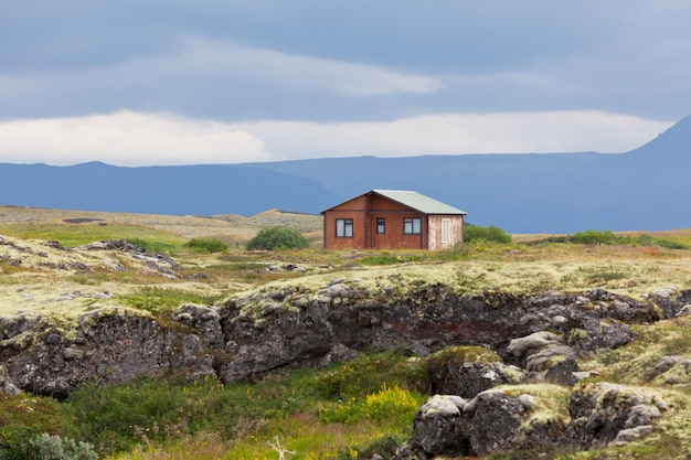 Small wooden cottage in iceland volcanic landscape