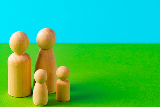 Small wooden figures of family members. family relationship symbol