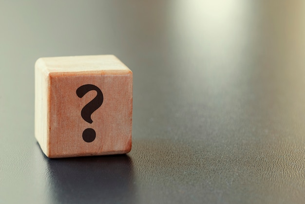Small wooden toy block with question mark
