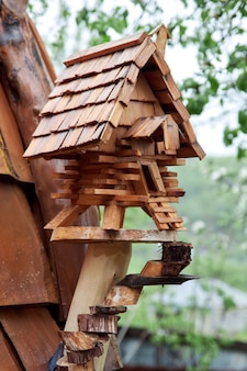 Small wooden treehouse. decorative bird feeder made of wood