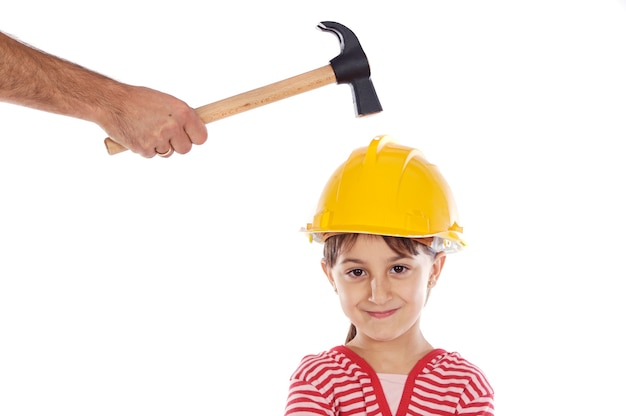 Small worker with a hammer and helmet on her head
