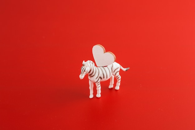 Small zebra with wooden heart