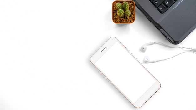 Smarphone, earphones and laptop on white background