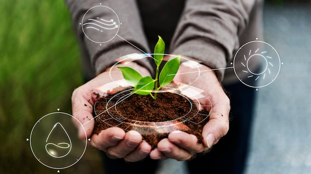 Smart agriculture iot with hand planting tree background
