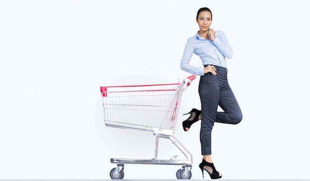 Smart asian woman with empty shopping cart in sideway for display product trolley on white isolated background