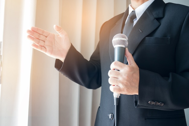Smart businessman speech and speaking with microphones