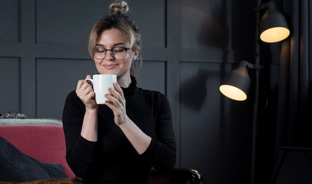 Smart businesswoman having a cup of coffee
