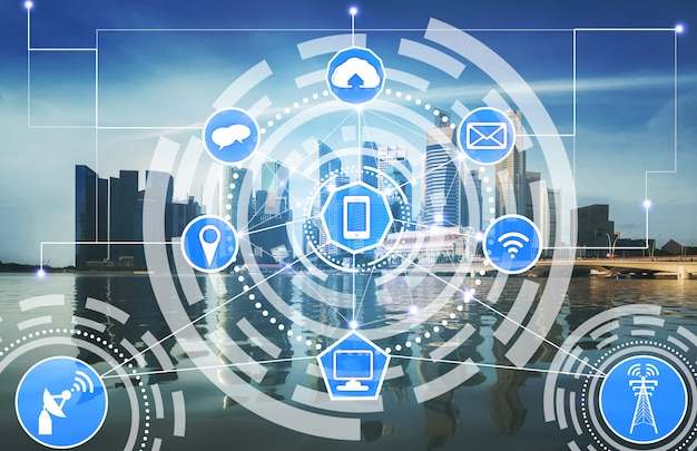 Smart city skyline with wireless communication network icons.