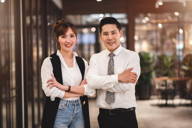 Smart couple sme business owner standing with crossed arms self-confidentin in new company