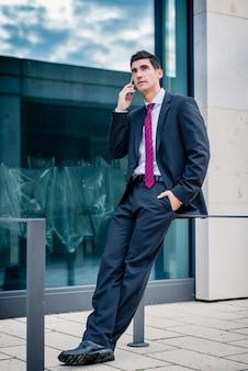 Smart dressed man talking in phone