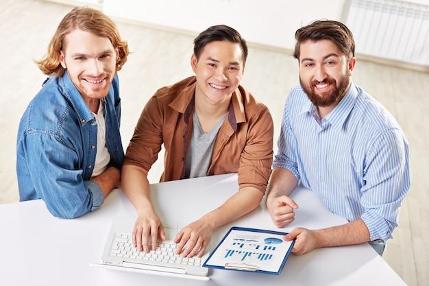 Smart employees using laptop at meeting