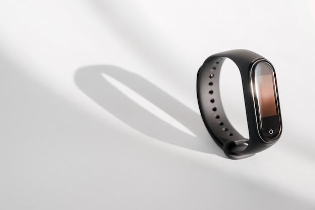 Smart fitness tracker isolated on white morning light background. sport bracelet. fitness band run tracker. black fitness watch.