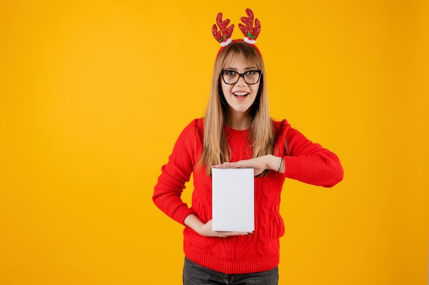 Smart funny woman holding book with copy space cover reading with glasses