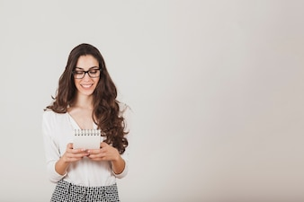 Smart girl with glasses holding an agenda