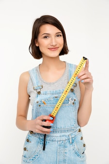 Smart happy woman builder, hold measuring tape