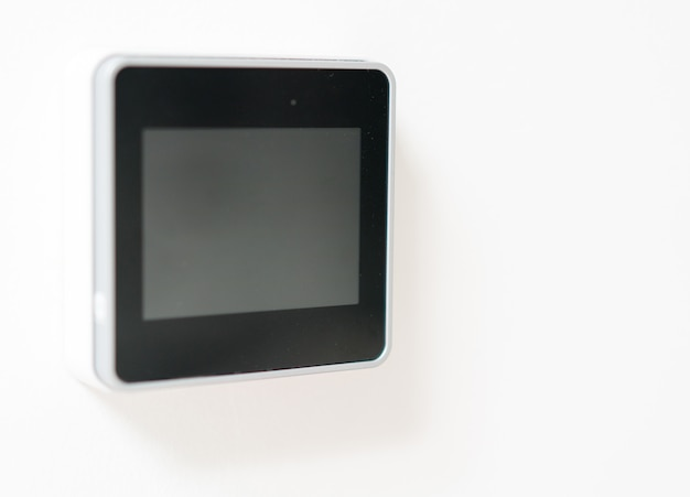 Smart home device on wall in modern living room house