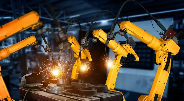 Smart industry robot arms in digital factory production