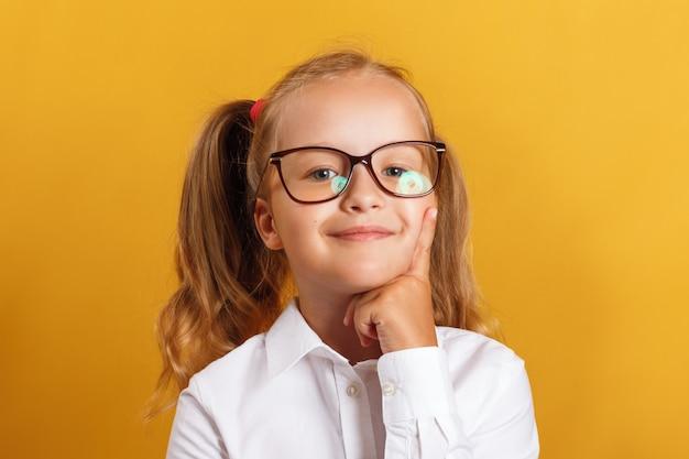 Smart little girl in glasses.