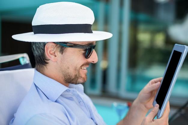 Smart man using digital tablet