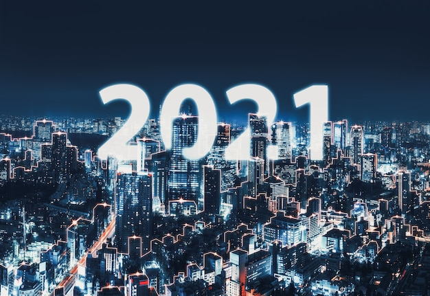 Smart network and connection technology concept, tokyo digital city with new year 2021 text background at night in japan, panorama view
