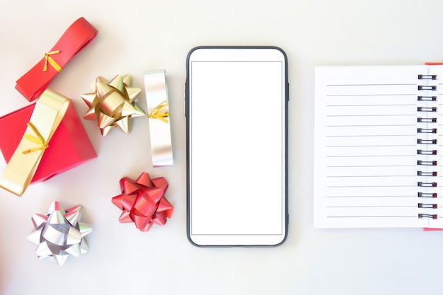 Smart phone and gift card, paper contact  with blank screen