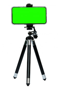 Smart phone of green screen on tripod isolated on white with clipping path