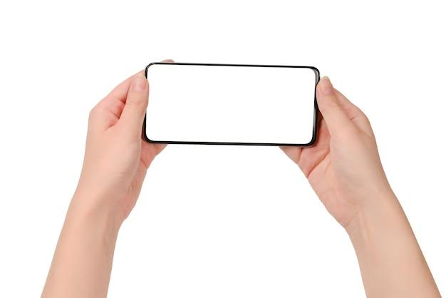 白い表面で隔離の女性の手のスマートフォン