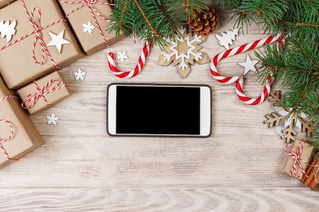 Smart phone mock up with rustic christmas decorations for app presentation