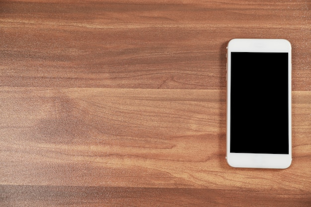 Smart phone on wood office desk