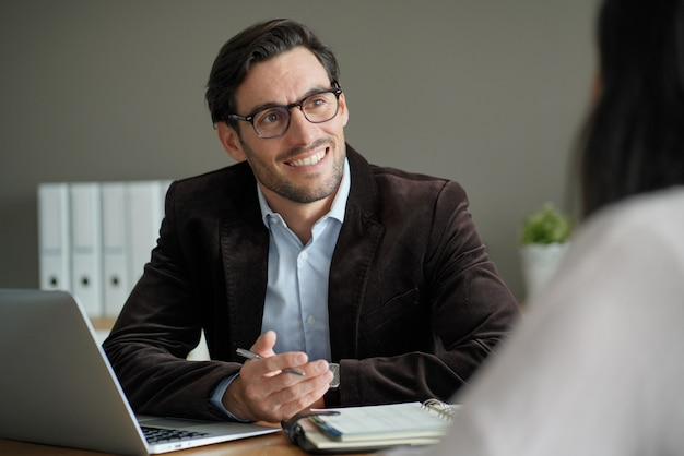 Smart professional male with client in office