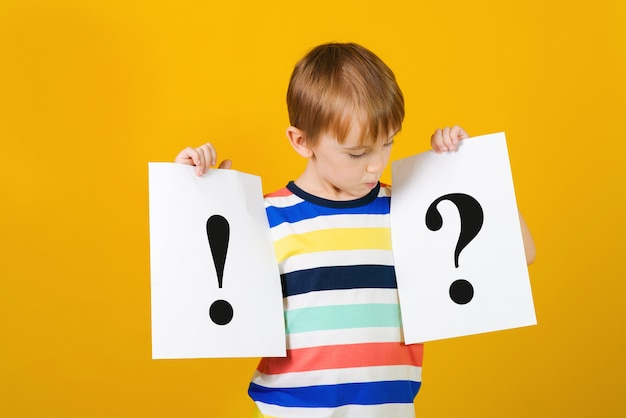Smart pupil is puzzled with question mark and exclamation mark.