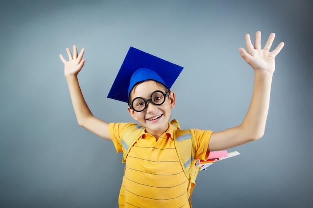 Smart schoolboy having fun