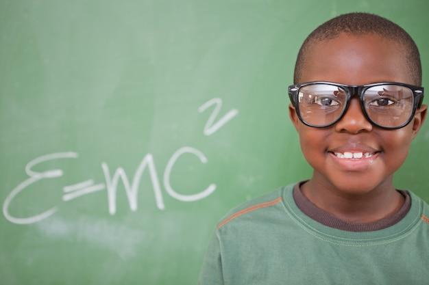 Smart schoolboy posing