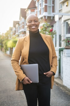Smart successful woman standing in the street