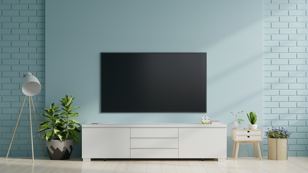 Smart tv on the blue wall in living room,minimal design.